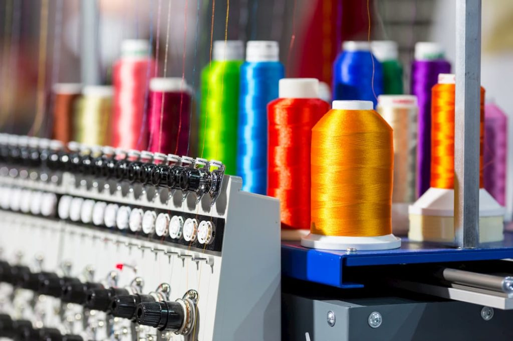embroidery machine with spools of different coloured thread