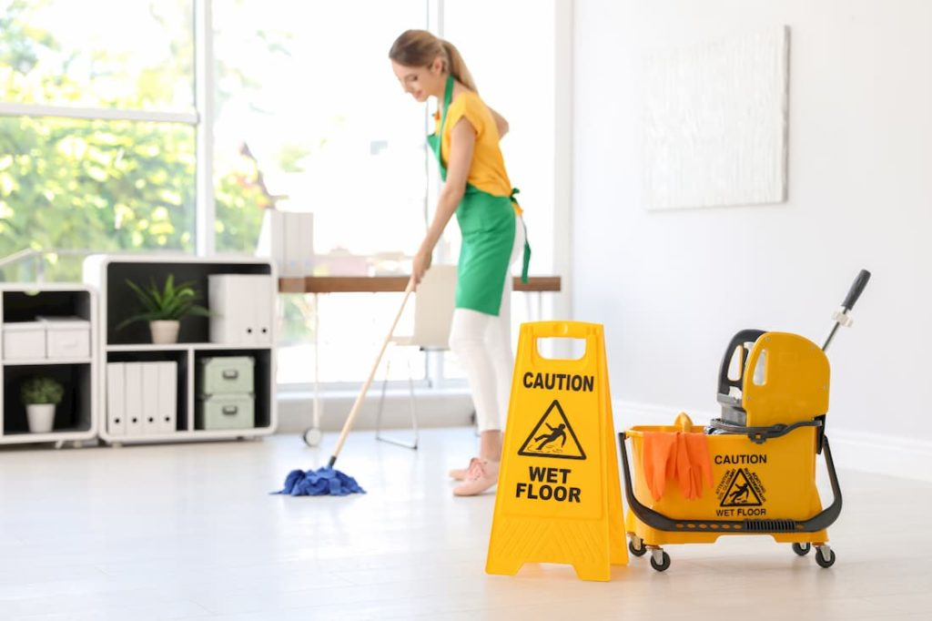 janitor supplies cleaner working mopping floor of commercial space