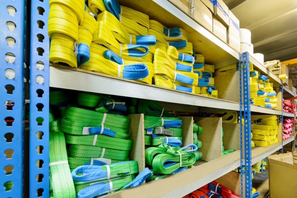 warehouse shelves with rows of lifting equipment