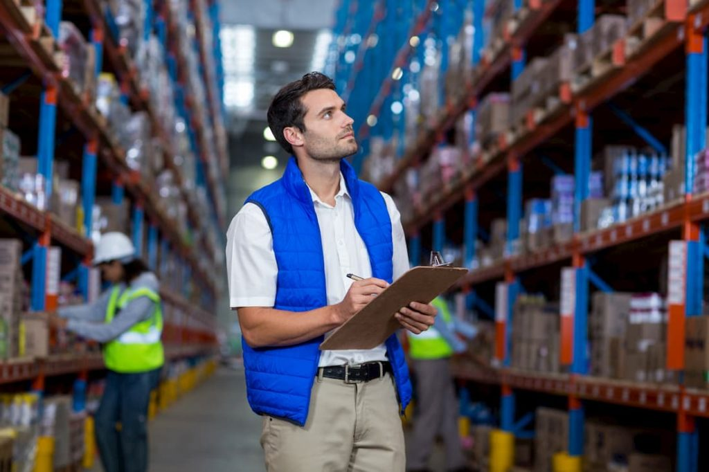 warehouse manager keeping stock of shelf items