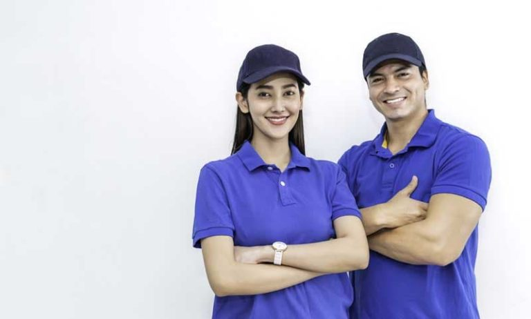 two members of staff standing together