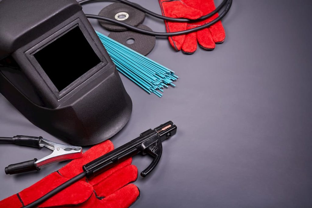assortment of welding equipment with grey backdrop