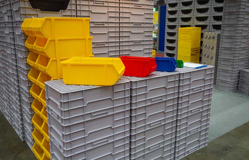 assortment of different colour plastic containers